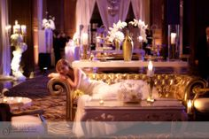 Bride lounges on gold sofa during a quick wedding reception portrait session at the Crystal Tea Room in Philadelphia. The room was designed by Evantine. Gold Sofa, Philadelphia Wedding, Sweetheart Table, Lounges, Event Design, Wedding Reception, Wedding Flowers, Crystal, Salons