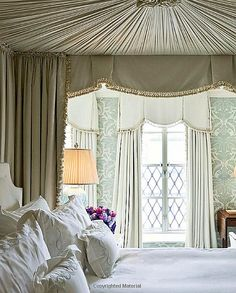 Love the wallpaper, window treatments, bed draperies and canopy.