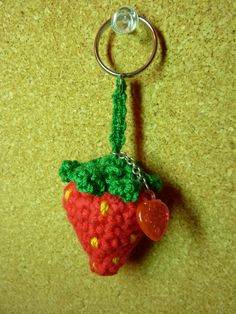 My second amigurumi strawberry,  which I turned into a keychain using macramé and a keychain ring. I recycled the ornament from a glitter pen which had gone dry ^.^     © Sweet Faery