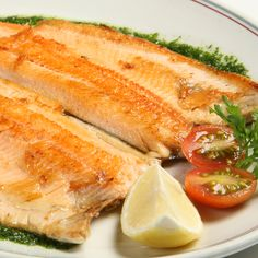 A flavorful and flaky trout recipe that will be a huge hit for dinner.. Garlic Herb Grilled or Baked Trout Recipe from Grandmothers Kitchen.