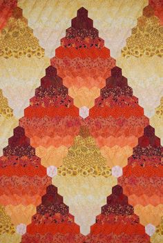 Just a picture, no true link to website or to the artist quilter.e