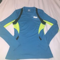 Fila Top Super cute Fila long sleeve top! Great condition! Features a small pocket for your phone in the front as shown in the second pic! Fila Tops Tees - Long Sleeve