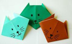 origami animaux amusants - des têtes de chats super mignonnes en papier plié rouge, vert et turquoise