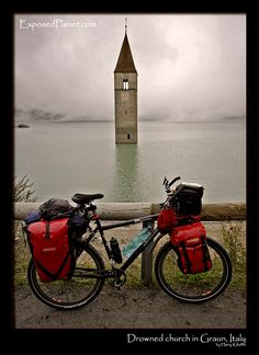 Cycle touring past the drowned church in Graun, Italy Must do!!