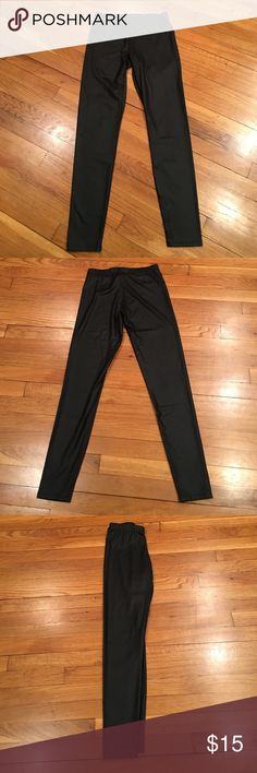 """Midnight Hour Shiny Black Leggings Size S These are a pair of coated shiny black leggings from Midnight Hour in a size small.  They are super comfy & have a sleek look.  Material is very stretchy & made of polyester/spandex.  The approx. measurements are 7"""" rise, 26"""" inseam & 13"""" across front of waist.  Worn only a few times they are in great condition. Midnight Hour Pants Leggings"""