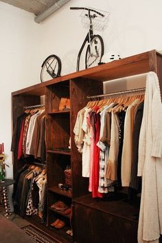 DIY wooden closet with clothing racks and shoe shelves