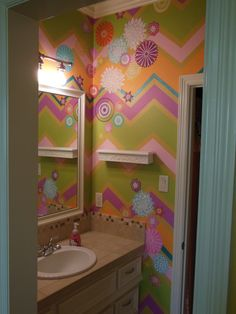 Bright chevron stripes and RDS flower stencils. Work by Tiffany Alexander of Blank Canvas Design Studio.