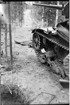 A Soviet T-26 tank destroyed during the Battle of Ilomantsi in Finland (26 July - 13 August, 1944). The Battle of Ilomantsi (a loss for the Soviets) was part of the larger Vyborg–Petrozavodsk Offensive to end Finland's involvement in the Great Patriotic War. Photo: SA-Kuva (Finnish Army Pictures).