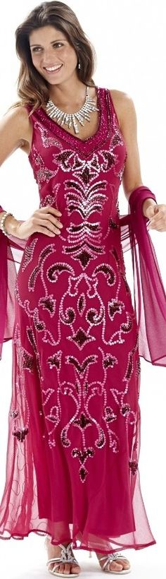Wear this cute (plus size) magenta / hot pink Gatsbyesque maxi dress to a party, a wedding, or a formal cruise night party. But, please wear it without a blingy necklace... to much... overkill. This gown doesn't need any more statements. Read updated article at: http://www.boomerinas.com/2013/06/26/flapper-fashion-trend-for-parties-cruises-weddings/