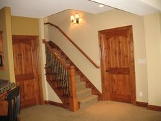 Open up part of your basement to have a handrailing, making the stairs feel less closed in. For more information visit www.carstensenhomes.com