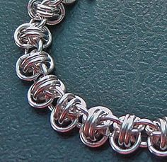 I love this chain maille!  Link doesn't work, but I think I can figure out the weave :)