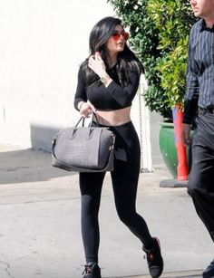 Kylie Jenner wearing Givenchy Croc-Embossed Medium Antigona Duffel, Audemars Piguet Royal Oak Watch, Victoria Beckham Classic Victoria Sunglasses, Nike Air Jordan 6 Retro Sneakers in Black/Infrared23, American Apparel Stretch Longsleeve Crop Top and American Apparel Cotton Spandex Jersey High Waist Leggings