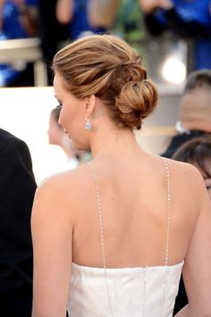Jennifer Lawrence's structural bun and more updo inspiration from the red carpet for #brides. #wedding