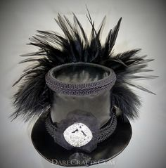 Slowdive Mini Stovepipe Topper #DHSP04 Mini top hat fascinator inspired by the Siouxsie and the Banshee's post-punk song. Covered with shiny black vinyl (pvc) paired with a black braided band, a large sparkly rhinestone brooch and spiky black feathers. www.darecrafts.com #darecrafts #creativelife #inspiration #costuming #divergent #embellishments