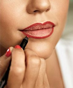 Jessica Alba's 4 Steps to Perfect Red Lips (Step 3: Even out any mess by retracing the line.)