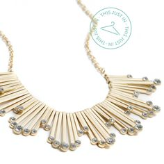 This just in: get fabulously festive with a statement necklace that will spice up any neckline! (Larson Crystal Fringe Statement Necklace)