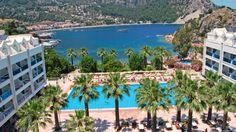 Monipuoliset palvelut tarjoava, hyvän palautteen saanut Otel Turunc on rauhallisella, luonnonkauniilla paikalla Turunçinlahden pohjukassa. Turunçin kylä palveluineen on n. 600 m:n päässä. Viihtyisä all inclusive -hotelli sopii erinomaisesti lapsiperheille. #Turunc #OtelTurunc #Turkki #loma #aurinkomatkat #lastenkanssa #AllInclusive Marmaris, Hotels And Resorts, Mansions, House Styles, Manor Houses, Villas, Mansion, Palaces, Mansion Houses