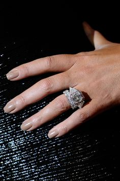 Nick Cannon and Mariah Carey -  The singer was presented with an engagement ring consisting of 59 diamonds, worth a reported 2 million dollars.