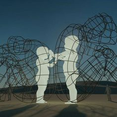 Burning Man Sculpture Reveals Inner Child Glowing Within Giant - Thought provoking burning man sculpture shows inner children trapped inside adult bodies