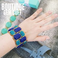 Boutique Gem Cuff Gorgeous gemstone cuff from a boutique. Only worn once so it's in great condition! Looks so cute on  colors are gold with different shades of blue! Boutique Jewelry Bracelets