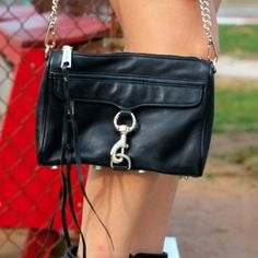 Black Rebecca Minkoff Mini Mac Bag! Black Rebecca Minkoff Mini Mac Bag! Normal wear -- no damage but stains inside the bag from makeup (assuming it can be cleaned from going to a cleaner). Gold hardware Rebecca Minkoff Bags Crossbody Bags