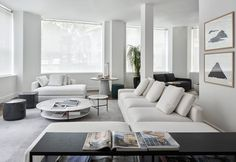A quiet, neutral palette of whites and grays create a sophisticated yet comfortable living room. Pictured, Harold sofa, Adrian coffee table, Bobo side table, Owen Lounge table, Charlot pouf, Hardy console table. #Meridiani #MeridianiLivingInteriors #Interiors #InteriorDesign Modern Furniture Stores, Comfortable Living Rooms, Outdoor Flooring, Low Tables, Table Storage, Modular Sofa, Furniture Collection, Chair Design, Lounge