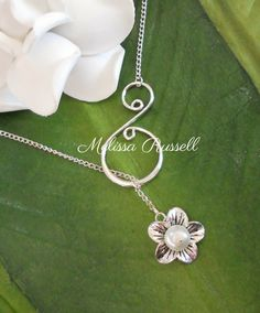 Silver Pearl Flower Lariat Swirl Necklace - Contact me if you need more than 1 necklace    This unique handcrafted lariat style necklace consists of a beautiful wire wrapped briolette that falls smoothly through a silver swirl piece. This necklace closes in the back with a lobster clasp.    Swirl Connector - Tarnish resistant lead free sterling silver plated (38mm x 21mm) swirl may vary depending on availability Flower - Oxidized Silver Tone Base Metal Flower Cap (17mm x 4.5mm)  Chain…
