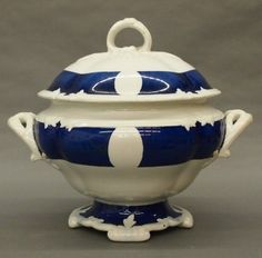 A turn of the century Ironstone tureen.  Molded body and cover with Navy Blue decoration