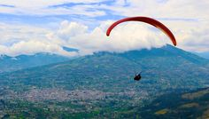 Paragliding Baños Ecuador. Paraglide enjoying the mountain scenery of the Ecuadorian highlands and feel the adrenaline of the sport.
