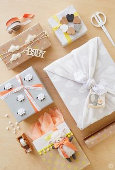 If you're headed to a baby shower, try these gift wrap ideas to really make your gift memorable. With a little DIY magic and a sweet pattern, you can perfectly wrap a baby shower gift! 5 Gift Wrap Ideas: Add a lamb to a bag Tie a heart-covered blanket around a box Use a garland as ribbon Tie a rattle to the top Add a flock of fuzzy sheep. #babygifts #giftboxes