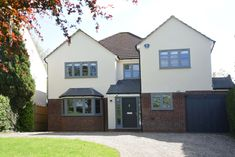 Flush casement timber windows and doors finished in Urbane grey.