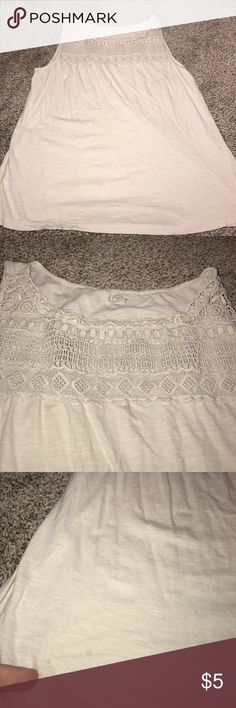 """Loft Lace Yoke Tank Loft Lace Yoke Tank. So cute!  Two small spots on the right side (see pics) and under the left arm side (see pics). Truly not very noticeable, I only saw them after a flash pic. Could possibly be removed, I haven't tried. Adorable alone or under a Cardigan or blazer.  Measures approximately 21"""" across chest and is 24"""" long from shoulder to bottom. LOFT Tops Tank Tops"""