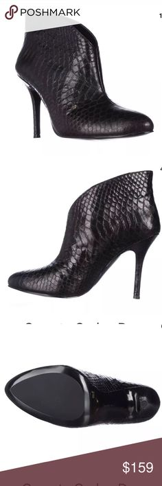 Vince Camuto New w/box black python leather boot Vince Camuto Caden ankle boot New with box  Heel: 4.00 inches Material: Leather Python pattern  Color: Black Toe-Shape: Round Toe The boot shaft measures approximately 4.00 inches tall and has an opening of 10.00 inches. Vince Camuto Shoes Ankle Boots & Booties