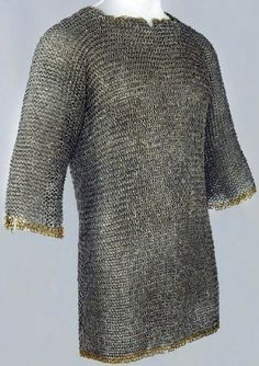 European (Germany) riveted mail hauberk, 2nd quarter of 15th century, carbon steel and copper alloy. Length: 71.1 cm. Diameter: 0.405 cm, of links. Weight: 8.84 kg. Maker's mark: '+ernart couwein', The Wallace collection. (Wallace A2).