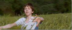 This opening scene in August Rush is so beautiful as the wind blows in the grass.you can almost hear the music =) August Rush, What Is Happiness, Dog Barking, Cinematography, Little Boys, The Voice, Grass, Believe, Waves