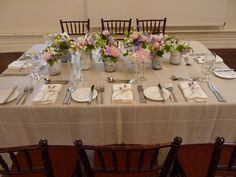 Table linen from Table Art. Hen Patchwork overlay, latte underlay, white linen spoke napkins.  Floral by Flair Flowers & Design.  www.tableart.com.au