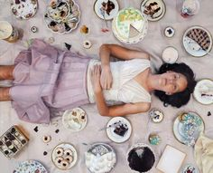 One of a series of photorealistic oil painting studies by and of Lee Price, who depicts herself binging on junk food.