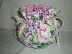 Multi Floral (Purple) Tea Pot Cozy - Fits 6 Cup Teapot - Reversible by Dot Sweeney. $19.95. Tea lovers rejoice! Now you can keep your tea 'snuggie warm' while your teapot looks PRETTY on your table! Don't forget that tea pot cozies would make a wonderful housewarming, wedding, birthday, or Christmas gift for tea loving friends, co-workers and family.