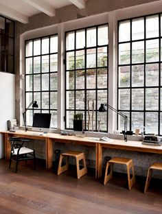 work space with a full length desk across the wall beneath the windows