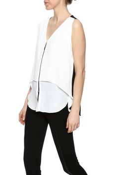Flowy and multi layer top with a white front and black back. Zipper detailing in the middle.  Zipper Front Top by Joseph Ribkoff. Clothing - Tops - Blouses & Shirts Clothing - Tops - Sleeveless New Jersey