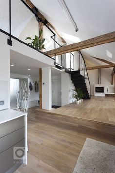 The reconstruction of this amazing loft apartment was carried out by B² Architecture in Prague, Czech Republic. The apartment belongs to a business Lofts, Attic Renovation, Attic Remodel, Loft Design, House Design, Home Interior Design, Interior Architecture, Attic Loft, Loft Interiors