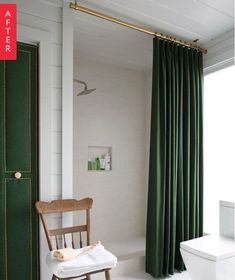 dark green floor to ceiling shower curtain and a brass rod