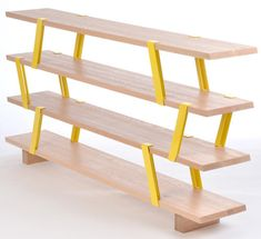 Montreal-based designer Olivier Desrochers created the Méo Shelf, a shelving system that resembles scaffolding. The modular system uses solid oak planks that are connected together with brightly colored steel supports that sit at an angle.