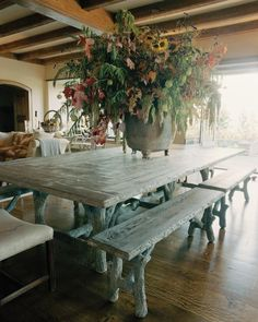 We decided that he would create two dining tables, one large and one smaller, with pink granite terrazzo tops. These were delivered six months later and were so wonderful that I decided to replace the formal skirted 90-inch round table that was in the living hall with a giant rectangular table and benches. This time the tabletop would be wood-grained cement, as would the four bench tops. I gave Carlos a deadline, begging him for the furniture before summer. Concrete Table, Concrete Art, Concrete Projects, Diy Projects, Martha Stewart Home, Vignette Design, Buy My House, Concrete Sculpture, Garden Furniture