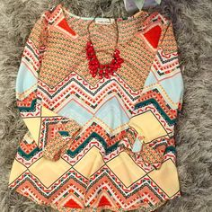 Great Wishful Park Top What a fun pattern!!!!! Goes with everything. Perfect with leggings and boots. Can dress up or down. Sleeves are a little longer than 3/4 and have a button embellishment. Super fun top! Wishful Park Tops Blouses