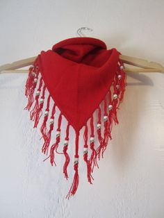 craft idea?  I think we could make this out of fabric cut (with pinking shears) in large bandana size triangles.  I made one like this as a kid at camp.  We cut the tassles and put beads on & tied knots at the end.  2nd-5th could do it alone.  Pre-K thru 1st couldn't cut fabric.