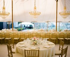 gold and pink tent...look at those chandeliers