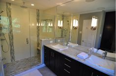 Gorgeous bath room with glass shower enclosure