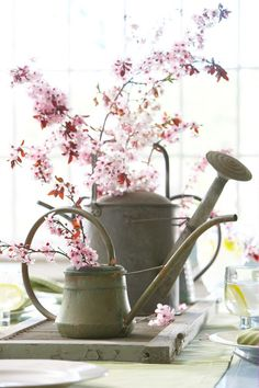 """Vintage Shutters as Table Runner """"Vintage watering cans, a wood wooden shutter and spring branches; now that's a combination for a pretty Spring table centerpiece for entertaining dinner guests."""""""