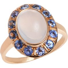 Luminescent and ever so inviting the central cabochon moonstone of this ring is white to gray in its tone. It brings in the light from every angle.